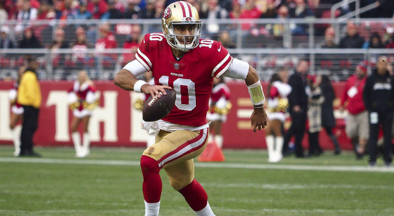 Jimmy Garoppolo runs against the Jacksonville Jaguars during the fourth quarter at Levi's Stadium in SF.