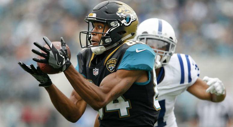 Keelan Cole catches the ball in front of Quincy Wilson during the second half at EverBank Field.