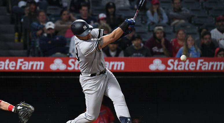 Yankees third baseman Gio Urshela hits an RBI single against the Los Angeles Angels in the 14th inning on April 22, 2019, at Angel Stadium of Anaheim.