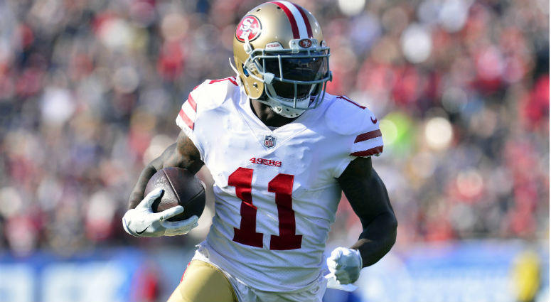 Marquise Goodwin runs the ball for a touchdown against the Los Angeles Rams during the first half at Los Angeles Memorial Coliseum.