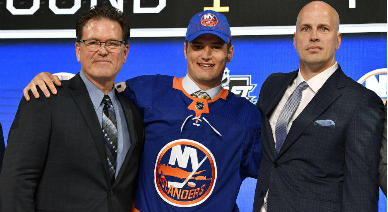 Oliver Wahlstrom poses for a photo with team representatives after being selected as the number eleven overall pick to the New York Islanders in the first round of the 2018 NHL Draft at American Airlines Center.