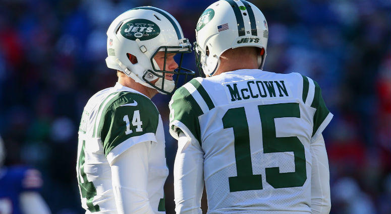 Sam Darnold and Josh McCown talk during a time-out in the second quarter at New Era Field.