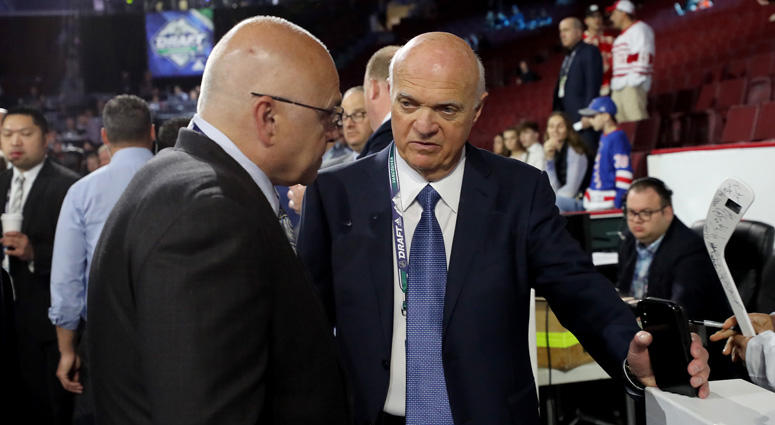Islanders president Lou Lamoriello chats with coach Barry Trotz during the NHL draft on June 22, 2019, in Vancouver, British Columbia.