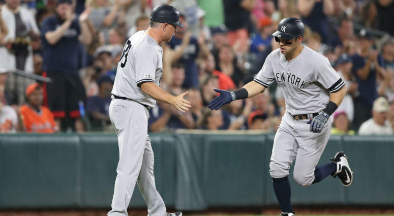 New York Yankees outfielder Mike Tauchman (39) congratulated by coach Phil Nevin (88) as he rounds the bases following his third inning solo home run against the Baltimore Orioles