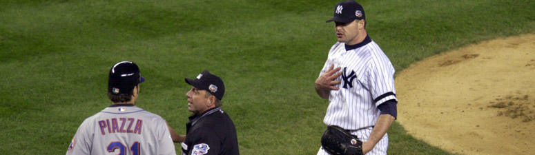 Yankees pitcher Roger Clemens (right) is separated from Mets catcher Mike Piazza (31) after Clemens threw a broken bat toward Piazza during Game 2 of the World Series on Oct. 22, 2000 at Yankee Stadium.