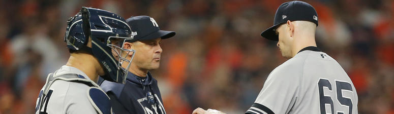 ames Paxton #65 of the New York Yankees is pulled by manager Aaron Boone during the third inning against the Houston Astros in game two of the American League Championship Series at Minute Maid Park on October 13, 2019 in Houston, Texas