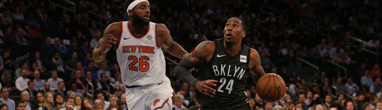 Nets forward Rondae Hollis-Jefferson drives against Knicks center Mitchell Robinson on Oct. 29, 2018, at Madison Square Garden.