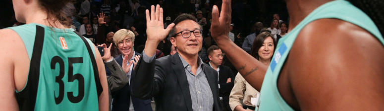 Joseph Tsai high-fives New York Liberty players after their exhibition game against the China national team at Barclays Center on May 5, 2019.