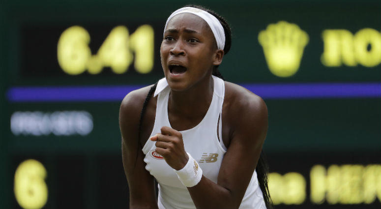 "United States' Cori ""Coco"" Gauff reacts after winning a point against Slovenia's Polona Hercog in a Women's singles match during day five of the Wimbledon Tennis Championships in London"