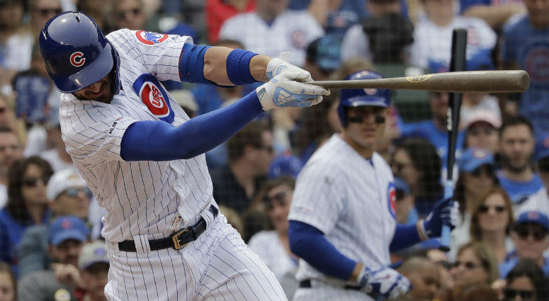 Chicago Cubs' Kris Bryant hits a double during the fifth inning of the team's baseball game against the New York Mets in Chicago.