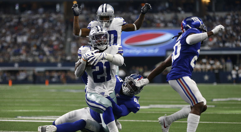 Dallas Cowboys running back Ezekiel Elliott (21) runs the ball for a touchdown after getting past New York Giants outside linebacker Alec Ogletree, center bottom, and Janoris Jenkins, right, as wide receiver Tavon Austin, rear, looks on in the second half