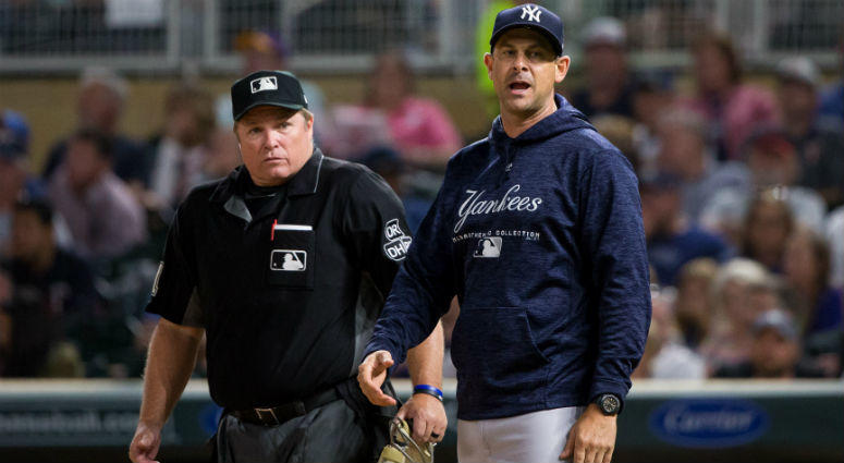 Aaron Boone argues with home plate umpire Marvin Hudson in the sixth inning against Minnesota Twins at Target Field.