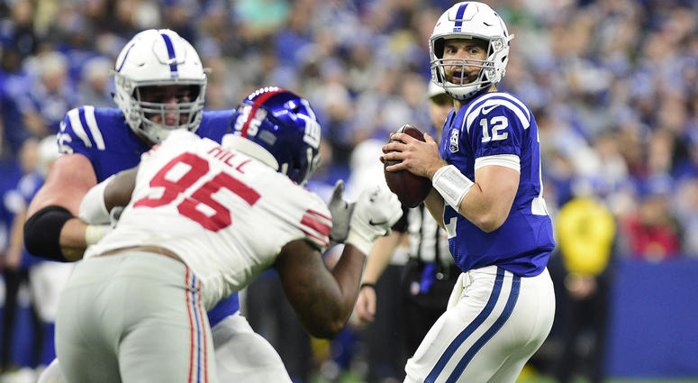 Dec 23, 2018; Indianapolis, IN, USA; Indianapolis Colts quarterback Andrew Luck (12) prepares to throw the ball in the first half against the New York Giants at Lucas Oil Stadium. Mandatory Credit: Thomas J. Russo-USA TODAY Sports
