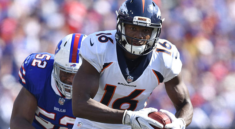 Denver Broncos wide receiver Bennie Fowler (16) runs for yards after a catch as Buffalo Bills middle linebacker Preston Brown (52) pursues during the third quarter of a game at New Era Field. Mandatory Credit: Mark Konezny-USA TODAY Sports