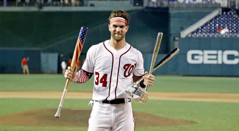 Bryce Harper celebrates winning the 2018 MLB home run derby at Nationals Ballpark.