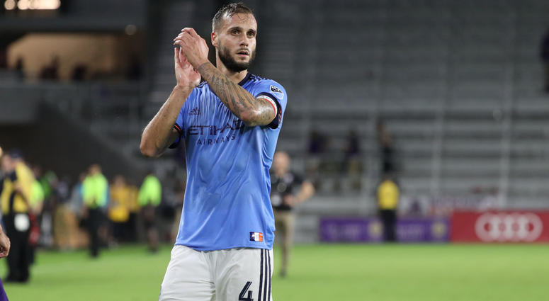 Jul 26, 2018; Orlando, FL, USA; New York City FC defender Maxime Chanot (4) celebrates with fans after defeating the Orlando City SC at Orlando City Stadium. Mandatory Credit: Kim Klement-USA TODAY Sports