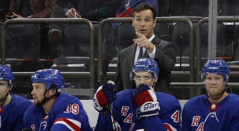Coach David Quinn behind the Rangers' bench