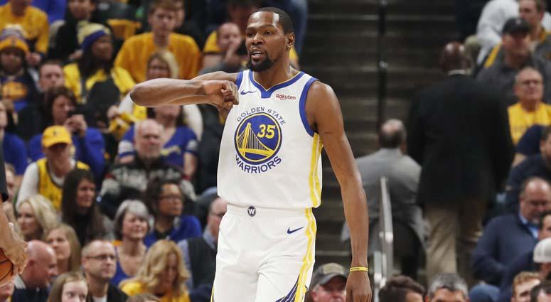 406569a5f76 Warriors forward Kevin Durant reacts by pounding on his chest after making  a play against the