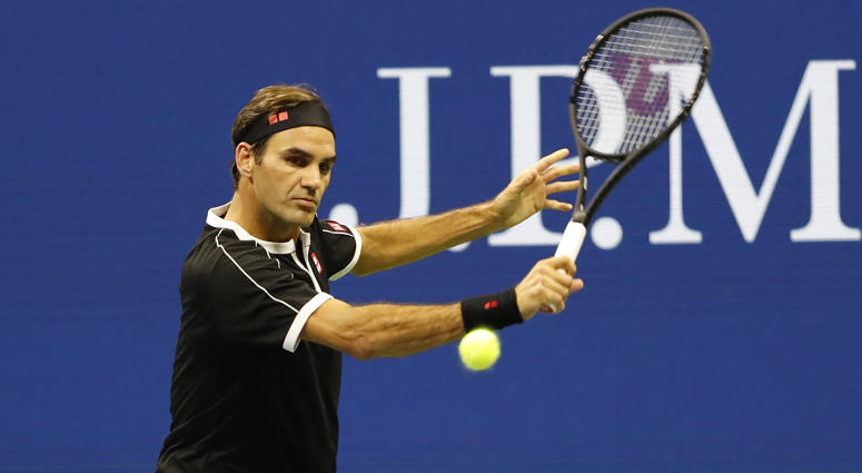 Roger Federer hits a backhand against Grigor Dimitrov in a quarterfinal match at the U.S. Open on Sept. 3, 2019.