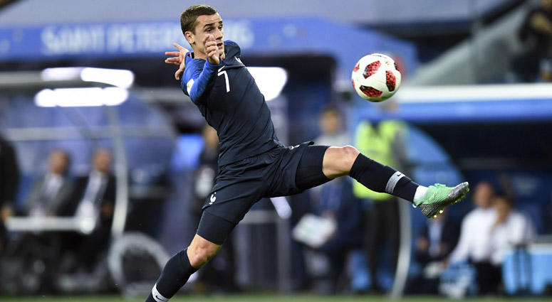France forward Antoine Griezmann lunges for the ball during the second half in the semifinals of the FIFA World Cup 2018 against Belgium on July 10, 2018, at Saint Petersburg Stadium in Moscow.