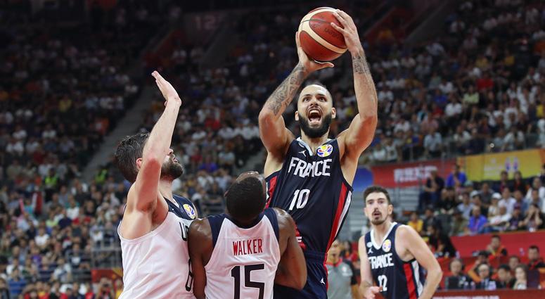 France's Evan Fournier shoots against USA's Joe Harris in the FIBA World Cup quarterfinals on Sept. 11, 2019, at Dongguan Basketball Center in Dongguan, China.