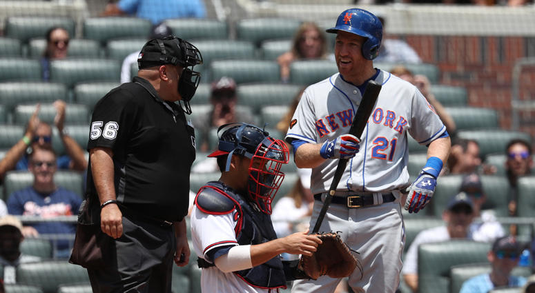 Todd Frazier argues a call by home plate umpire Eric Cooper after striking out in the ninth inning against the Braves on June 13, 2018, at SunTrust Park in Atlanta.