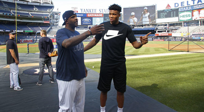 Milwaukee Bucks basketball player Giannis Antetokounmpo and Yankees pitcher CC Sabathia chat before the Yankees' game against the Tampa Bay Rays on July 15, 2019, at Yankee Stadium.