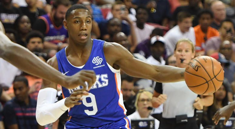 RJ Barrett #8 of the New York Knicks brings the ball up the court against the Phoenix Suns during the 2019 NBA Summer League
