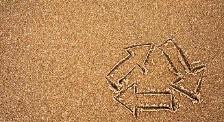 Recycle symbol on beach