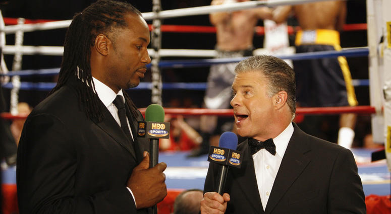 HBO commentators Lennox Lewis and Jim Lampley discuss a fight on May 19, 2007 at the FedEx Forum in Memphis, Tennessee.