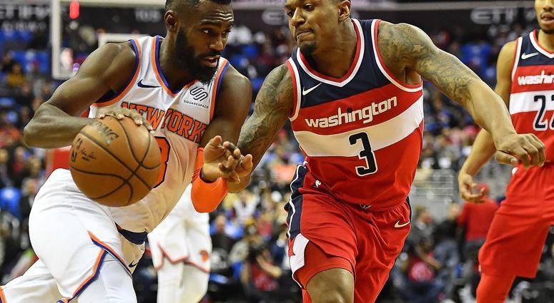 New York Knicks forward Tim Hardaway Jr. dribbles as Washington Wizards guard Bradley Beal defends at Capital One Arena in Washington, DC on Mar 25, 2018.