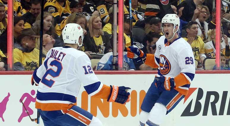 Islanders center Brock Nelson (29) reacts with right wing Josh Bailey after scoring a goal against the Penguins during Game 3 of their first-round playoff series on April 14, 2019, at PPG PAINTS Arena in Pittsburgh.