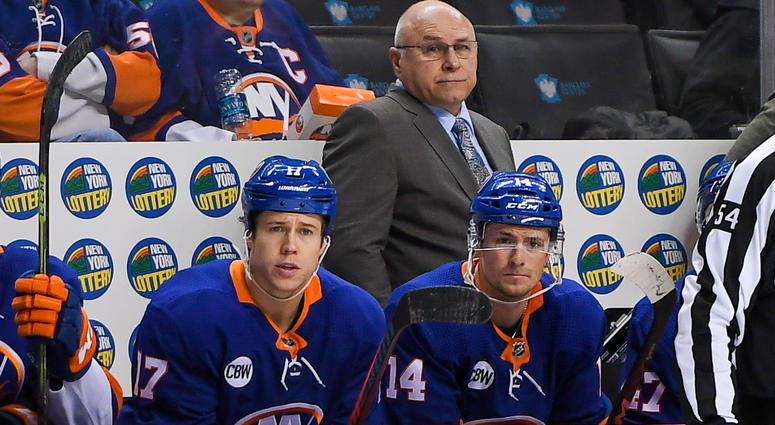 Nov 26, 2018; Brooklyn, NY, USA; New York Islanders Head Coach Barry Trotz (center) looks on from behind the bench against the Washington Capitals during the third period at Barclays Center. Mandatory Credit: Dennis Schneidler-USA TODAY Sports