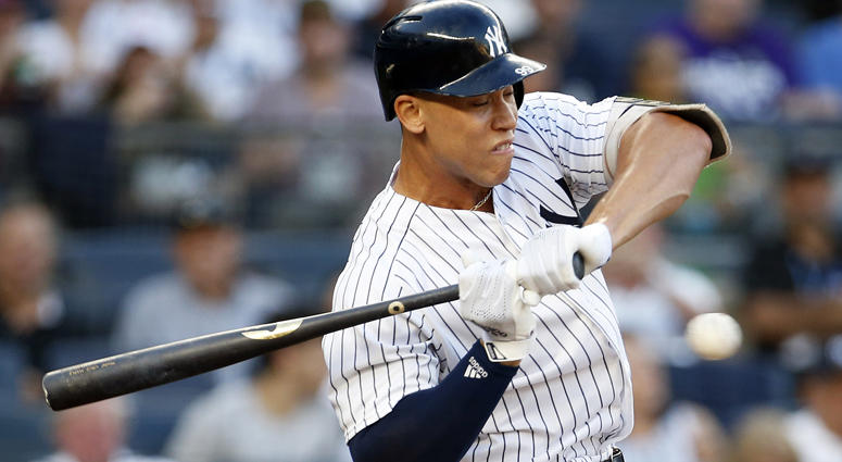 Yankees designated hitter Aaron Judge (99) reacts to being hit by a pitch against the Kansas City Royals on July 26, 2018, at Yankee Stadium.