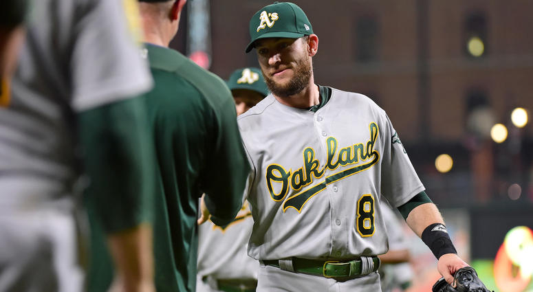 Sep 11, 2018; Baltimore, MD, USA; Oakland Athletics second baseman Jed Lowrie (8) high fives teammates after beating the Baltimore Orioles 3-2 at Oriole Park at Camden Yards. Mandatory Credit: Evan Habeeb-USA TODAY Sports