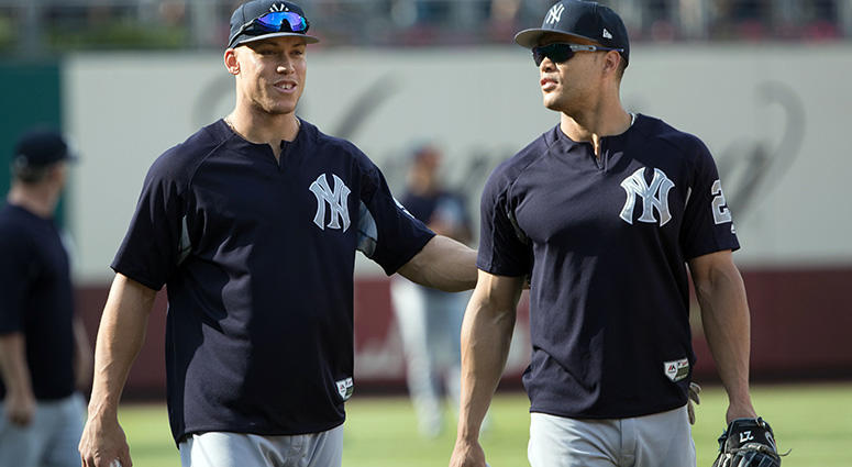 Jun 26, 2018; Philadelphia, PA, USA; New York Yankees right fielder Aaron Judge (99) and left fielder Giancarlo Stanton (27) before a game against the Philadelphia Phillies at Citizens Bank Park. Mandatory Credit: Bill Streicher-USA TODAY Sports