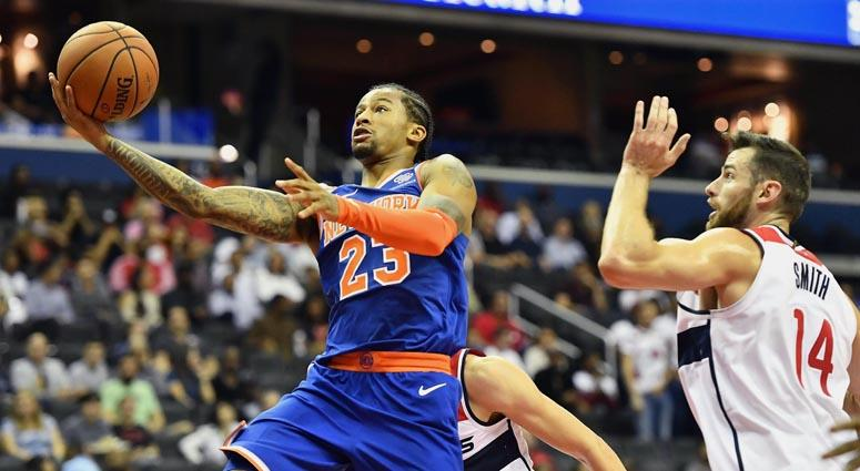 Knicks guard Trey Burke (23) shoots against Wizards forward Jason Smith on Oct. 1, 2018, at Capital One Arena in Washington.