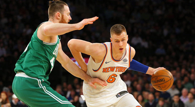 Knicks power forward Kristaps Porzingis drives against Celtics center Aron Baynes on Dec. 22, 2017, at Madison Square Garden.