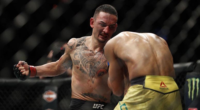 Max Holloway (left) fights Jose Aldo during UFC 218 on Dec. 3, 2017, at Little Caesars Arena in Detroit.