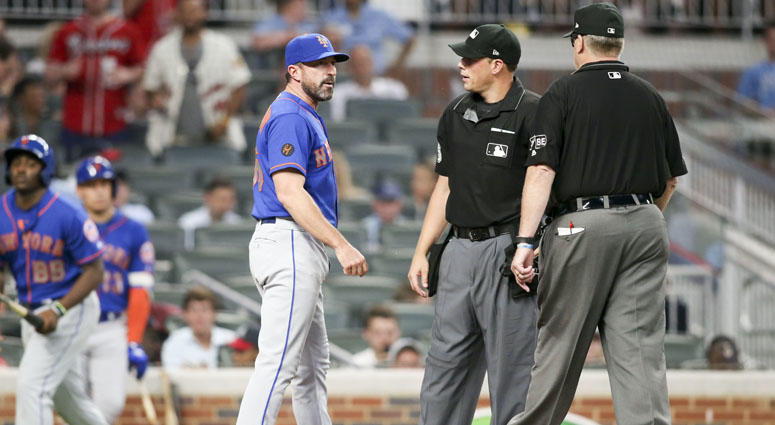Mets manager Mickey Callaway argues with umpires on June 12, 2018, at SunTrust Park in Atlanta.