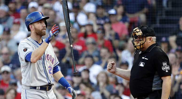 Mets third baseman Todd Frazier tosses his bat after striking out against the Red Sox on Sept. 16, 2018, at Fenway Park in Boston.