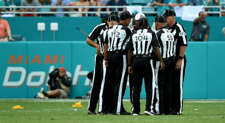 NFL referees work a game in Miami