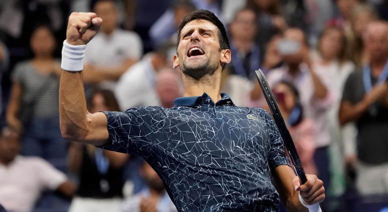 Novak Djokovic celebrates match point against Kei Nishikori in the U.S. Open semifinals at the USTA Billie Jean King National Tennis Center.