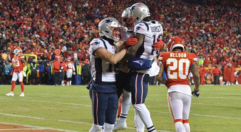 Patriots wide receiver Phillip Dorsett (13) celebrates with teammates after scoring a touchdown during the second quarter of the AFC Championship game against the Kansas City Chiefs on Jan. 20, 2019, at Arrowhead Stadium.