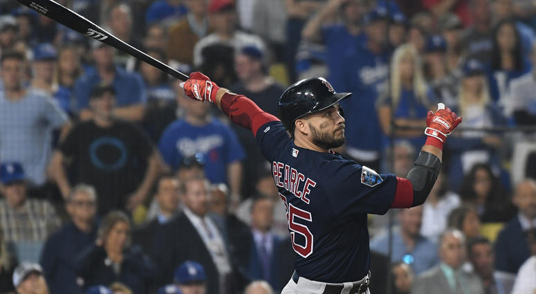 Red Sox first baseman Steve Pearce hits a three-RBI double in the ninth inning of Game 4 of the World Series against the Dodgers at Dodger Stadium in Los Angeles.