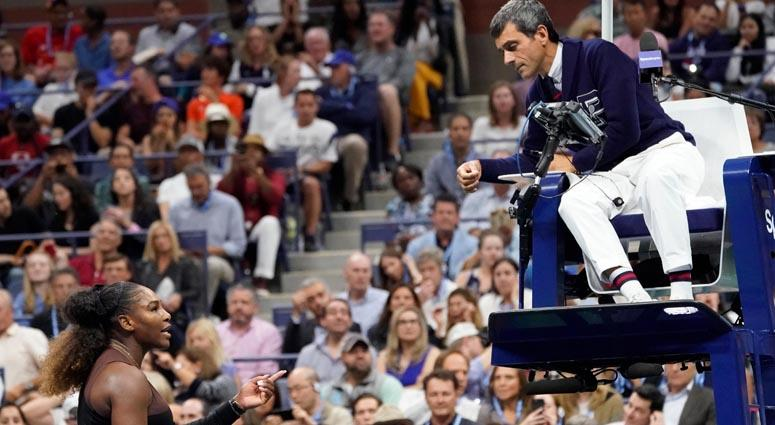 Serena Williams argues with chair umpire Carlos Ramos while playing Naomi Osaka in the U.S. Open women's final on Sept. 8, 2018, at the USTA Billie Jean King National Tennis Center.