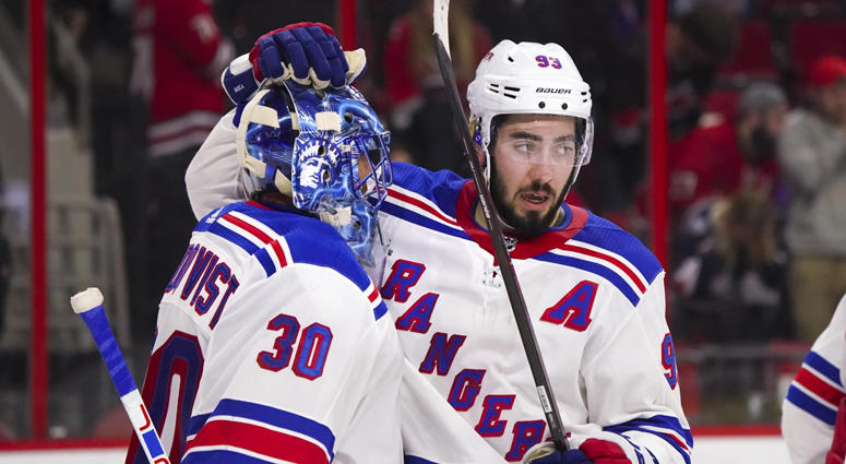 Rangers goalie Henrik Lundqvist (30) celebrates with forward Mika Zibanejad after their win against the Carolina Hurricanes on March 31, 2018, at PNC Arena in Raleigh, North Carolina.
