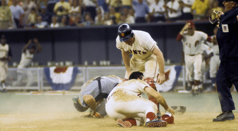 The National League's Pete Rose (14) collides with American League catcher Ray Fosse to score the winning run in the 1970 All-Star Game on July 14, 1970, at Riverfront Stadium in Cincinnati.