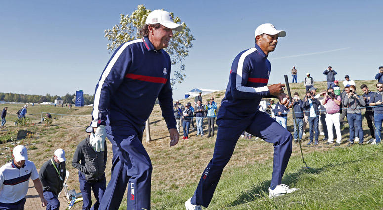 Phil Mickelson and Tiger Woods walk to the 7th tee during a Ryder Cup practice round on Sept. 25, 2018, at Le Golf National in Saint-Quentin-en-Yvelines, France.