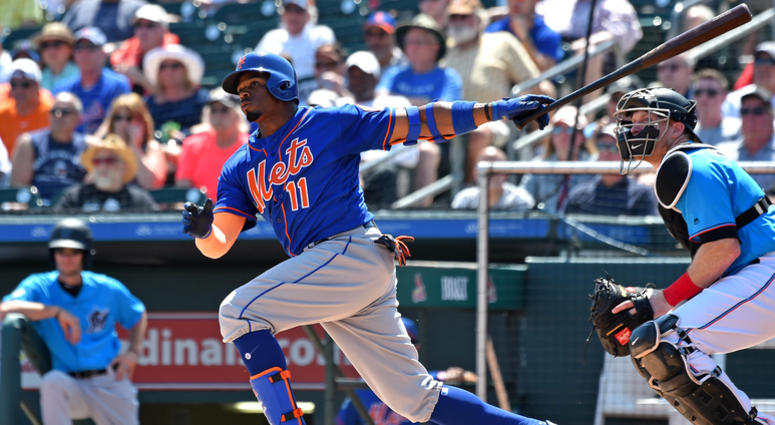 Mar 12, 2019; Jupiter, FL, USA; New York Mets second basemen Rajai Davis (11) hits a double against the Miami Marlins during a spring training game at Roger Dean Chevrolet Stadium. Mandatory Credit: Steve Mitchell-USA TODAY Sports